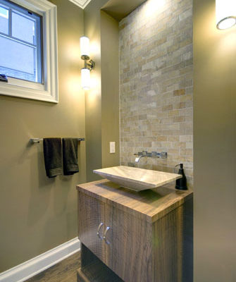 1344886205_Powder room with custom claro walnut cabinet and onyx tile